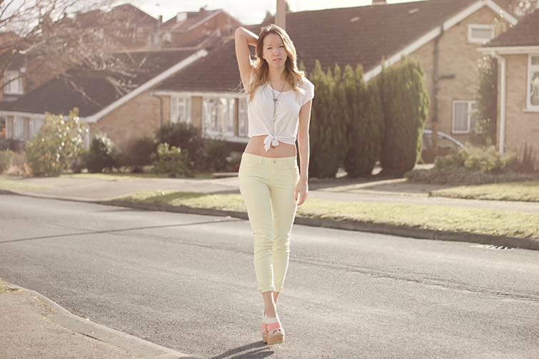 White tee and yellow pastel jeans