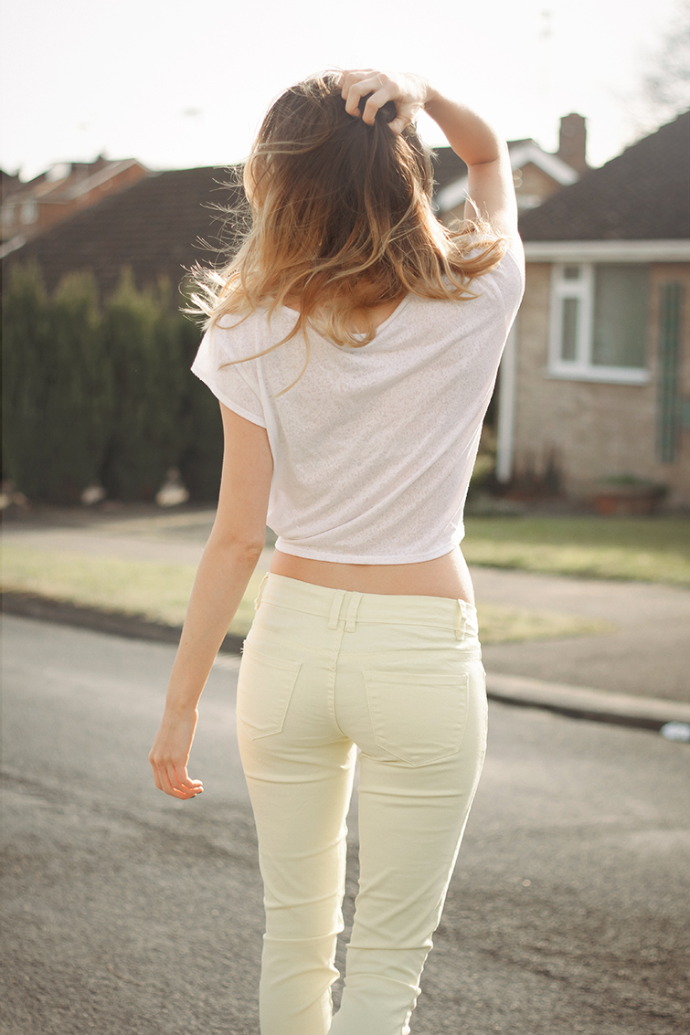 White tee and yellow jeans