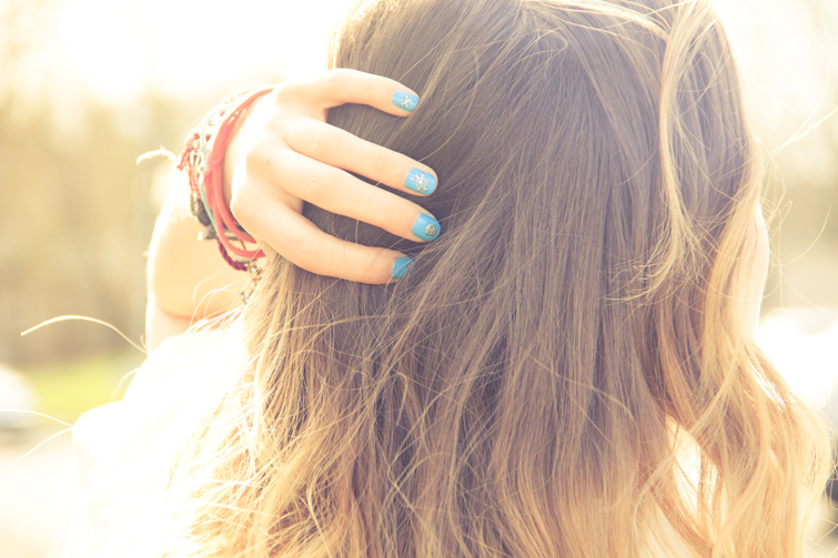 Bracelets and blue nails with nail tattoos