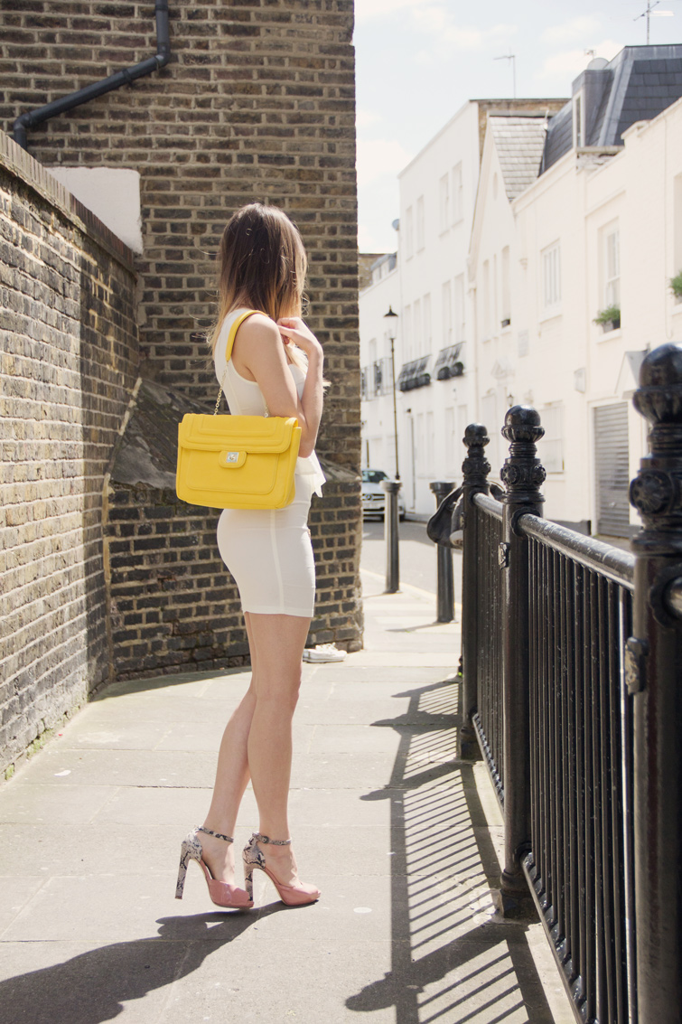 White peplum dress, neon yellow bag, snakeskin heels