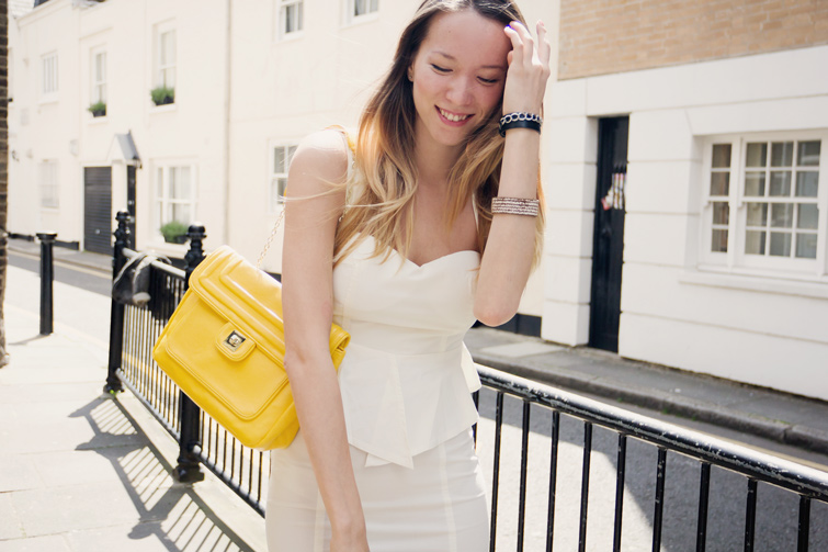 White peplum dress, neon yellow bag