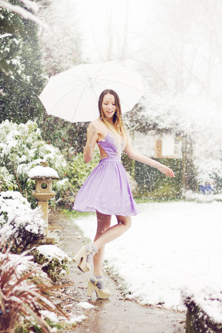 Girl in dress in the snow photo