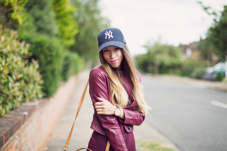 Girls in leather jacket baseball caps