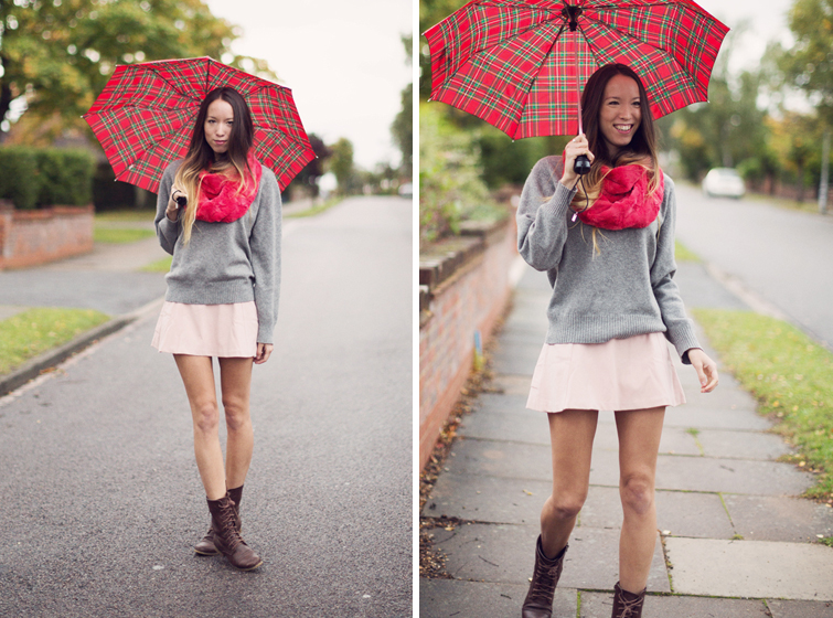 Pink pastel skirt, grey jumper, brown boots