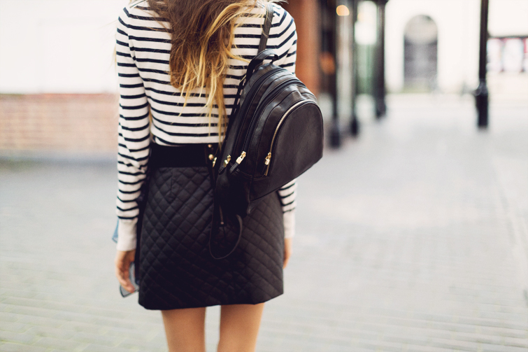 Leather look backpack and skirt