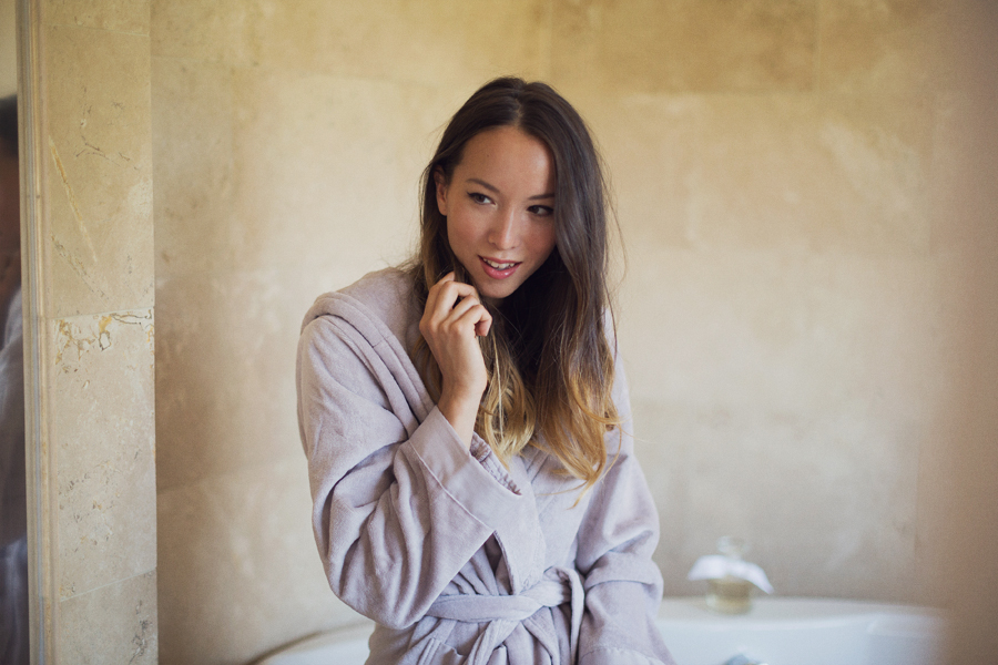 Girl in bathroom in bathrobe with ombre hair
